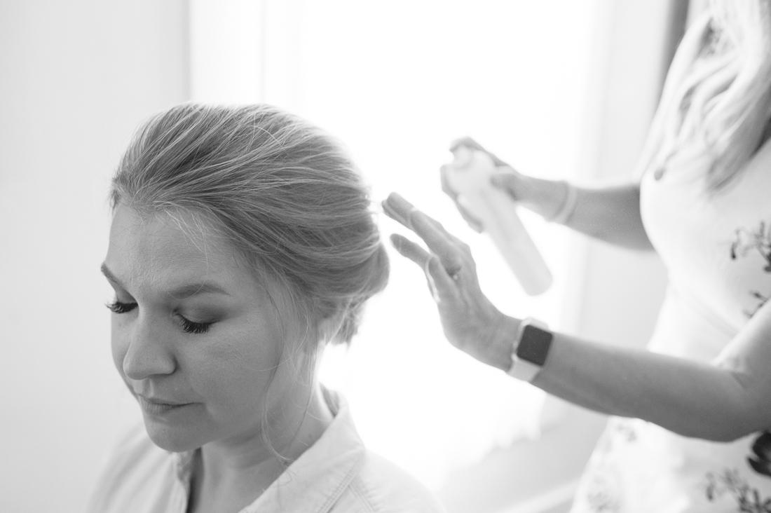 hairspraying the bride