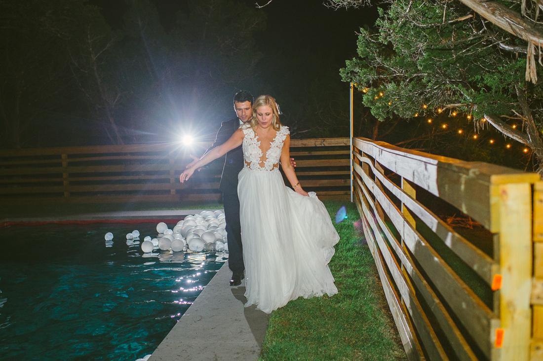 bride and balloons at night