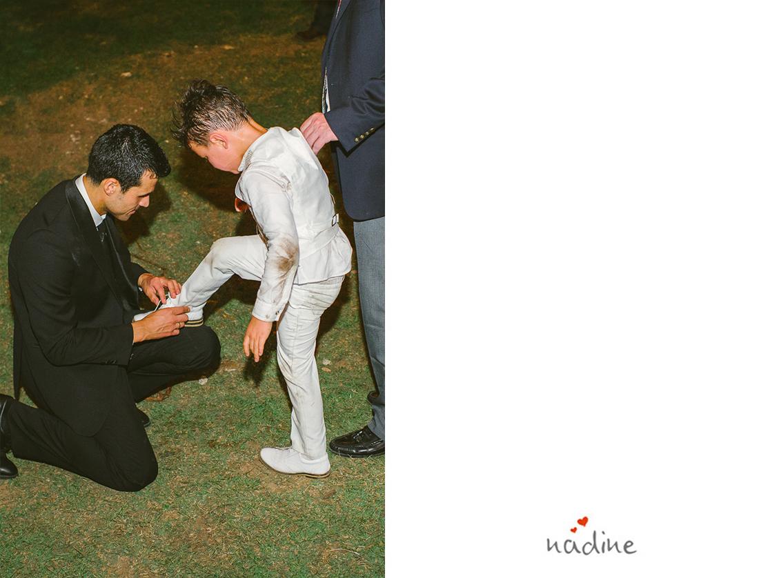 groom helping ringbearer