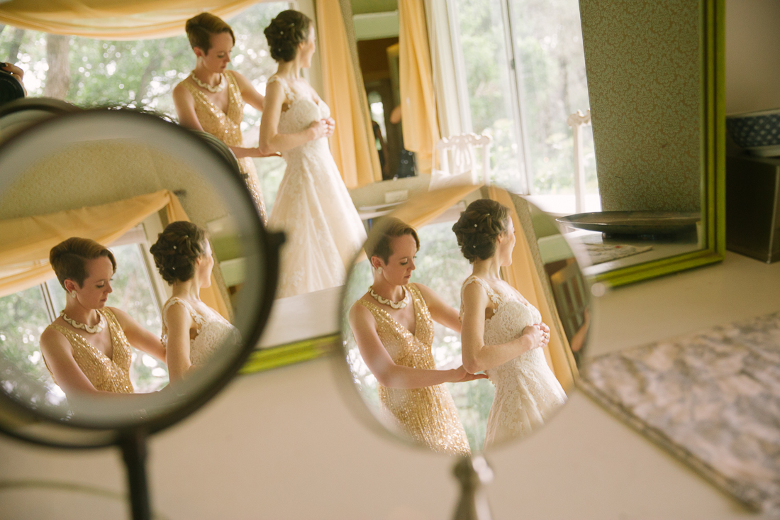 three reflections of a bride getting ready