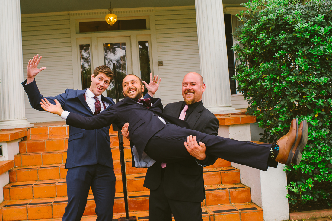 groom and groomsmen in front of winfield inn