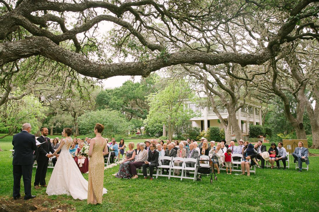 wedding ceremony under oak trees