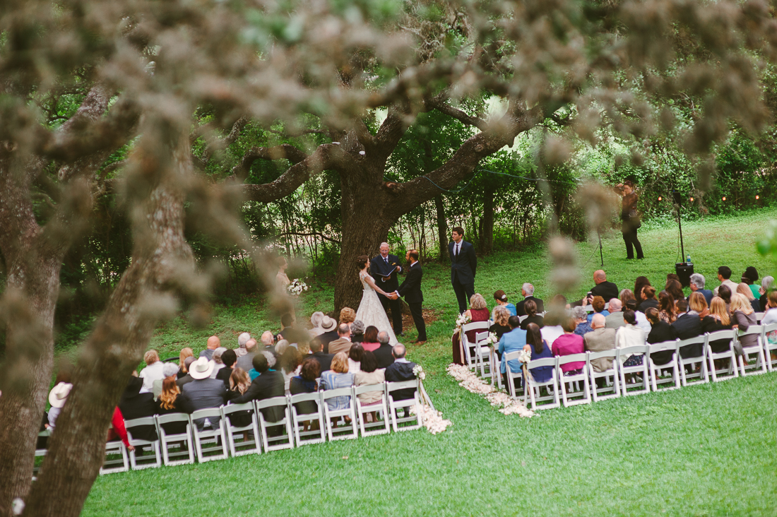 winfield inn wedding ceremony under trees