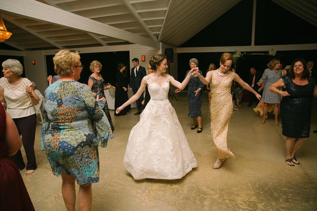 bride and sister of bride dancing