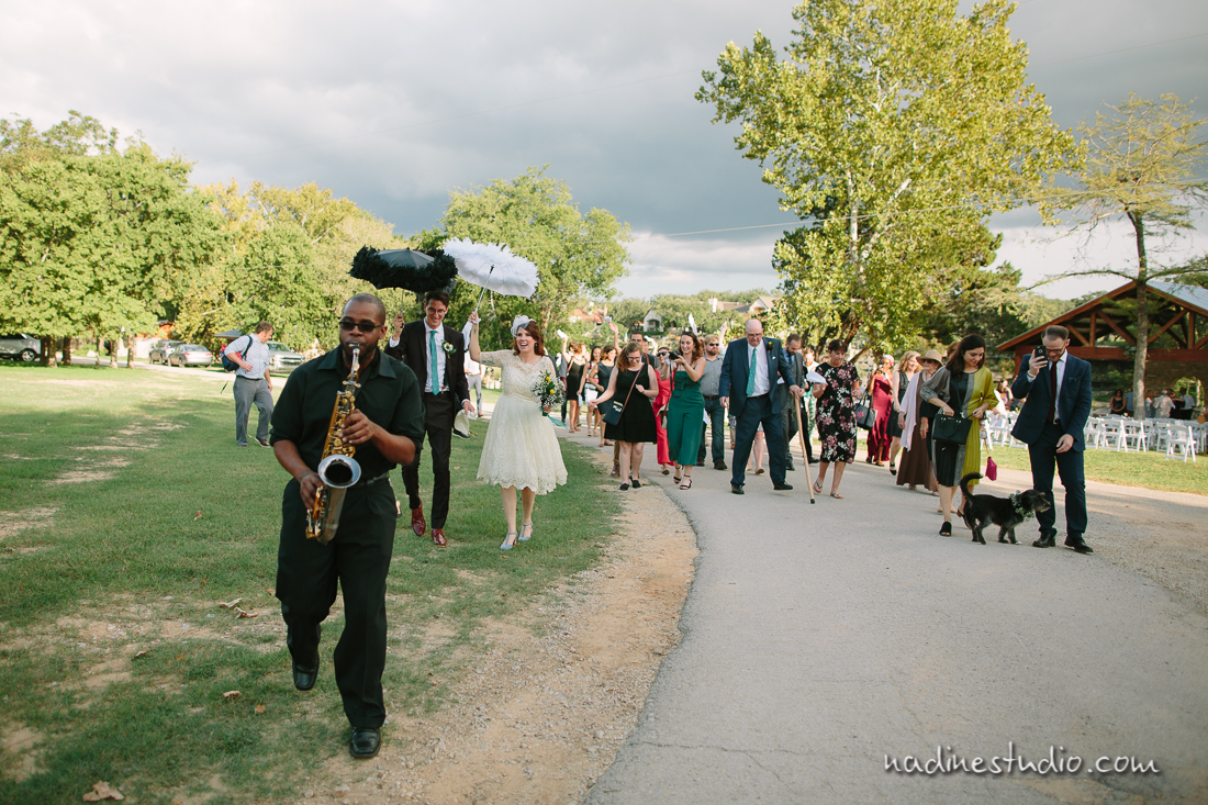 saxophone player leading out the ceremony